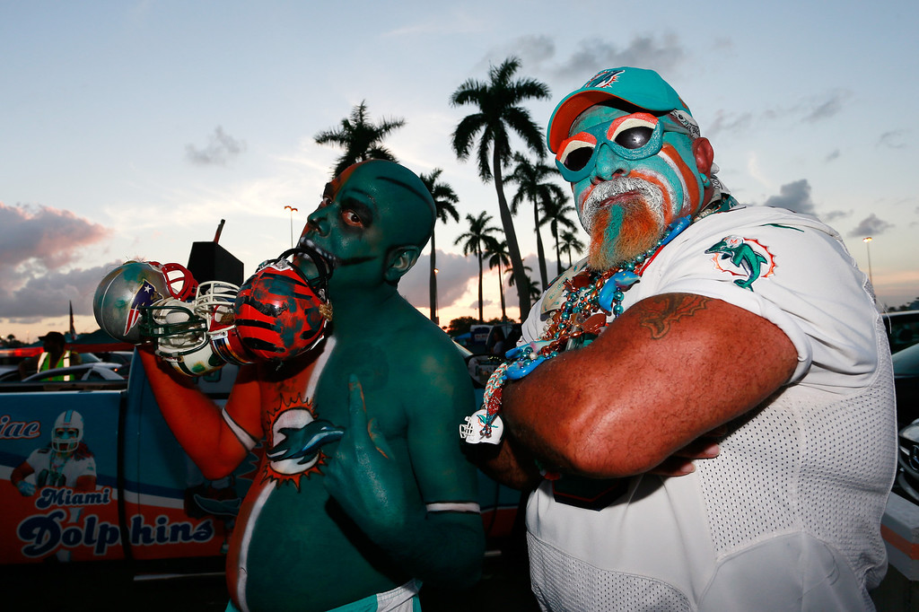 . MIAMI GARDENS, FL - OCTOBER 31: Fans pose for photographs on Halloween prior to the game between the Miami Dolphins and the Cincinnati Bengals at Sun Life Stadium on October 31, 2013 in Miami Gardens, Florida. (Photo by Chris Trotman/Getty Images)