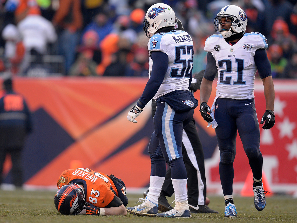 . Denver Broncos wide receiver Wes Welker (83) lays on the field after getting a concussion in the second quarter. (Photo by John Leyba/The Denver Post)