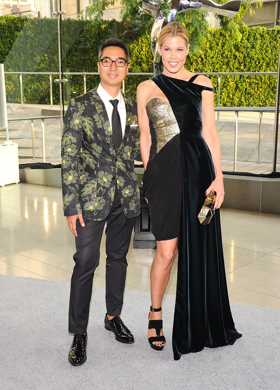 . Designer Rafe Totengco (L) and Mary Alice Stephenson attend the 2013 CFDA Fashion Awards on June 3, 2013 in New York, United States.  (Photo by Jamie McCarthy/Getty Images)