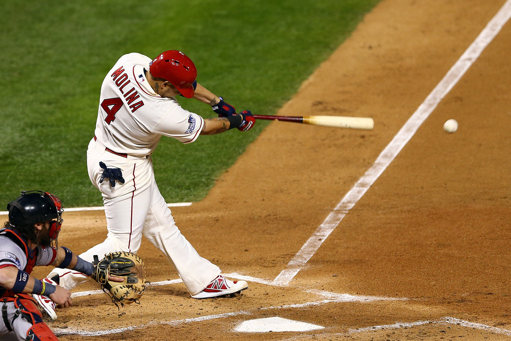 . ST LOUIS, MO - OCTOBER 26:  Yadier Molina #4 of the St. Louis Cardinals hits a RBI single in the first inning against the Boston Red Sox during Game Three of the 2013 World Series at Busch Stadium on October 26, 2013 in St Louis, Missouri.  (Photo by Elsa/Getty Images)