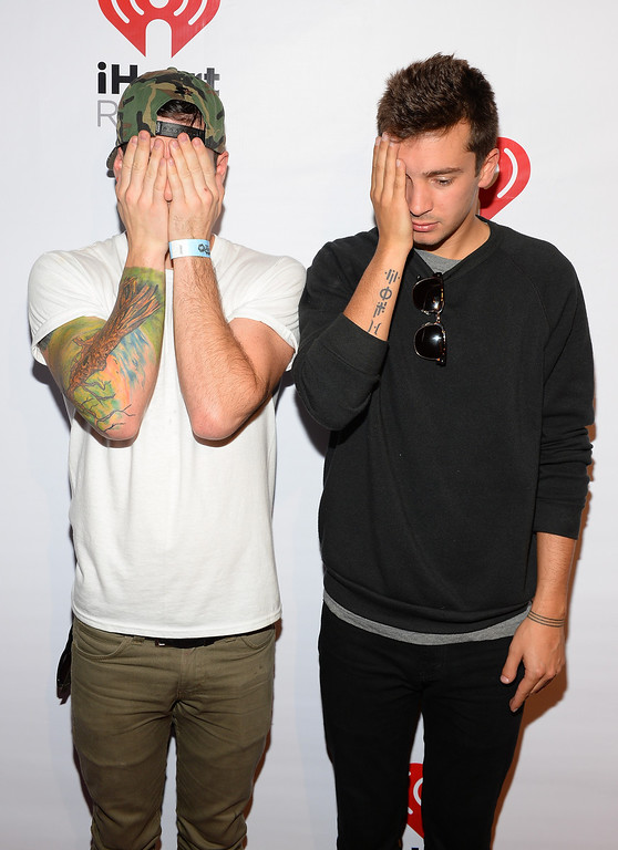. Musicians Josh Dun (L) and Tyler Joseph of Twenty One Pilots attend the iHeart Radio Music Festival Village on September 21, 2013 in Las Vegas, Nevada.  (Photo by Mark Davis/Getty Images for Clear Channel)