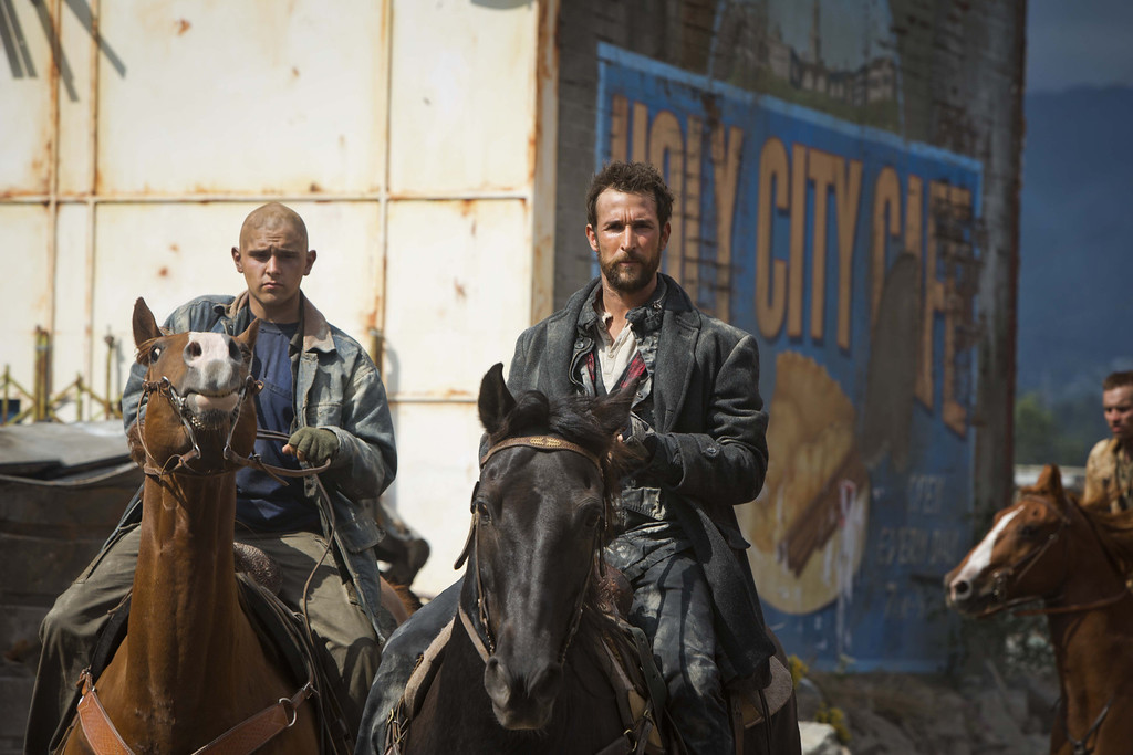 . Tom Mason (Noah Wyle) rides into town from battle. Photo Credit: James Dittiger