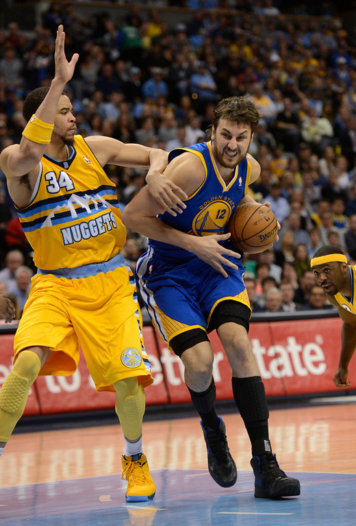 . DENVER, CO. - APRIL 23: Golden State Warriors center Andrew Bogut (12) dribbles in the lane against Denver Nuggets center JaVale McGee (34) in the third quarter. The Denver Nuggets took on the Golden State Warriors in Game 2 of the Western Conference First Round Series at the Pepsi Center in Denver, Colo. on April 23, 2013. (Photo by John Leyba/The Denver Post)