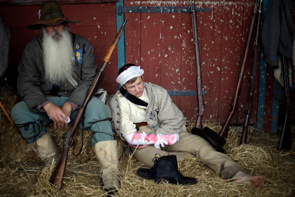 . Floridians portray wounded soldiers from the 1st N.C. Infantry as part of demonstration of a Confederate field hospital during ongoing activities commemorating the 150th anniversary of the Battle of Gettysburg, Friday, June 28, 2013, at the Daniel Lady Farm in Gettysburg, Pa.  Union forces turned away a Confederate advance in the pivotal battle of the Civil War fought July 1-3, 1863, which was also the warís bloodiest conflict with more than 51,000 casualties. (AP Photo/Matt Rourke)