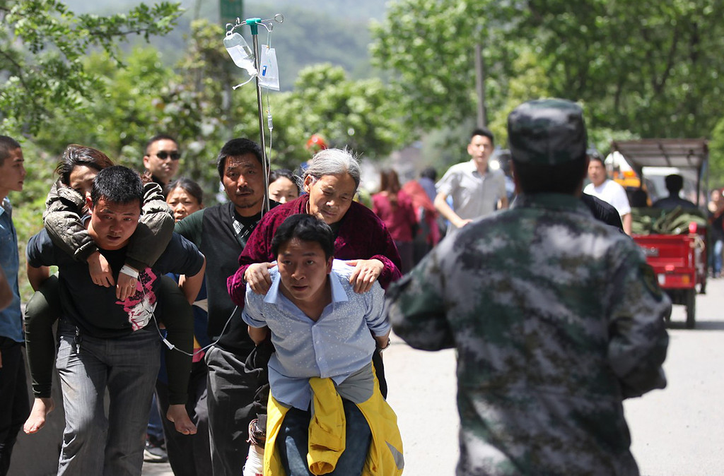 . Residents help carry injured people to the hospital after an earthquake hit Ya\'an City in Lushan County, southwest China\'s Sichuan province on April 20, 2013. The death toll from an earthquake on April 20 in China\'s southwestern Sichuan province has reached 100 with more than 2,000 others injured, government officials said. AFP PHOTOSTR/AFP/Getty Images