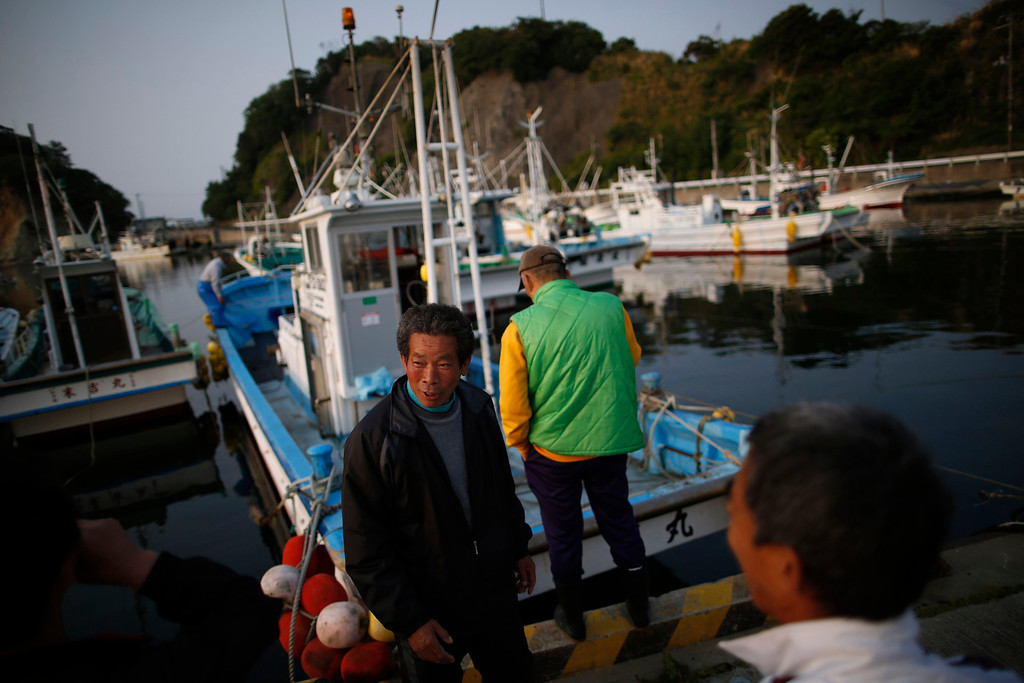 . 61-year-old captain Shigeru Katayose (C) and his boat crew are seen as they prepare to take part in a census of fish close to the Fukushima Daiichi nuclear power plant, in Hisanohama port in Iwaki, Fukushima prefecture May 27, 2013. Commercial fishing has been banned near the tsunami-crippled nuclear complex since the March 2011 tsunami and earthquake. The only fishing that still takes place is for contamination research, and is carried out by small-scale fishermen contracted by the government. Picture taken May 27, 2013. REUTERS/Issei Kato
