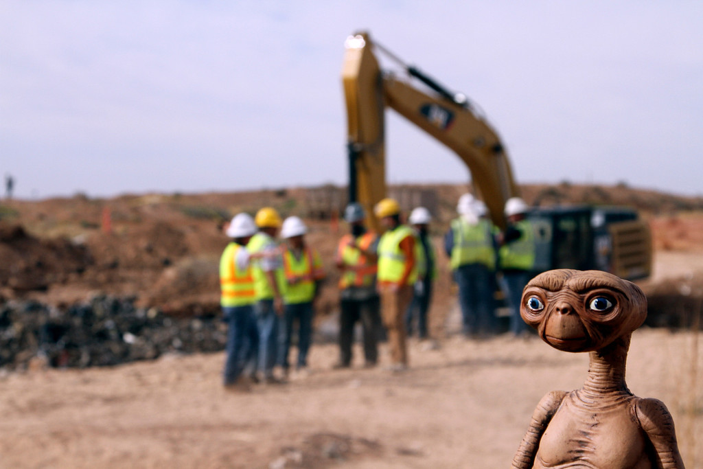 ". An E.T. doll is seen while construction workers prepare to dig into a landfill in Alamogordo, N.M., Saturday, April 26, 2014. Producers of a documentary are digging in the landfill in search of millions of cartridges of the Atari \'E.T. the Extra-Terrestrial\' game that has been called the worst game in the history of videogaming. A New York Times article from 1983 reported that Atari cartridges of ""E.T. The Extraterrestrial\"" were dumped in the landfill in Alamogordo.  (AP Photo/Juan Carlos Llorca)"