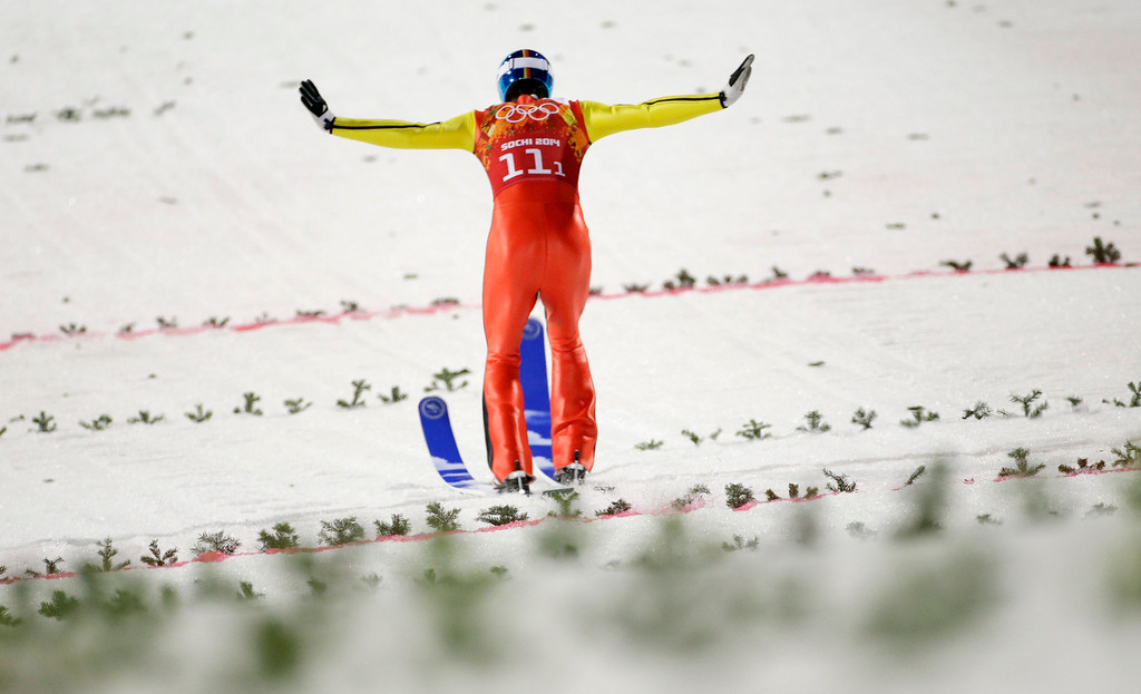 . Germany\'s Andreas Wank lands his second attempt during the ski jumping large hill team competition at the 2014 Winter Olympics, Monday, Feb. 17, 2014, in Krasnaya Polyana, Russia. (AP Photo/Gregorio Borgia)
