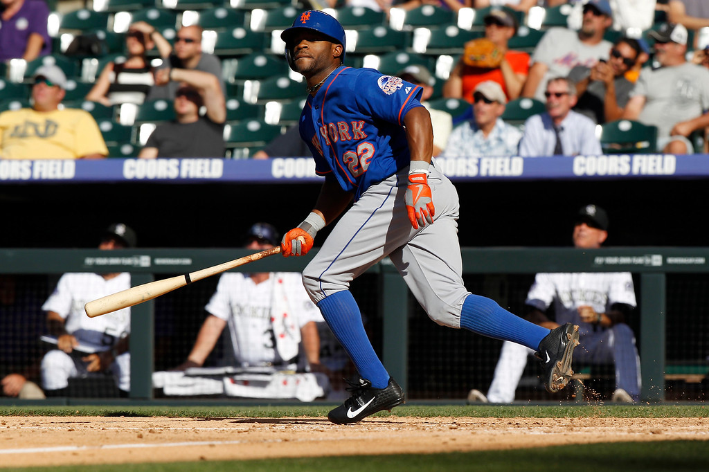 . New York Mets\' Eric Young, Jr., follows the flight of his fly out against the Colorado Rockies to end the top of the fifth inning of a baseball game in Denver on Thursday, June 27, 2013. (AP Photo/David Zalubowski)