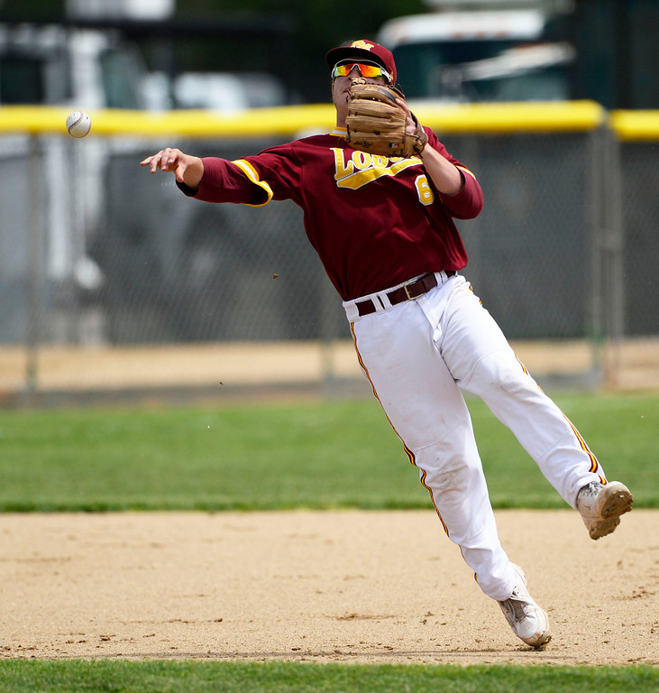. DENVER, CO. - MAY 23: Rocky Mountain SS, Daniel Ciraula, throws to first to get Jack Gillett, Cherry Creek, out at first in the second inning of play during the Colorado State 5A baseball playoffs at All City Field Friday afternoon, May 23, 2014. (Photo By Andy Cross / The Denver Post)