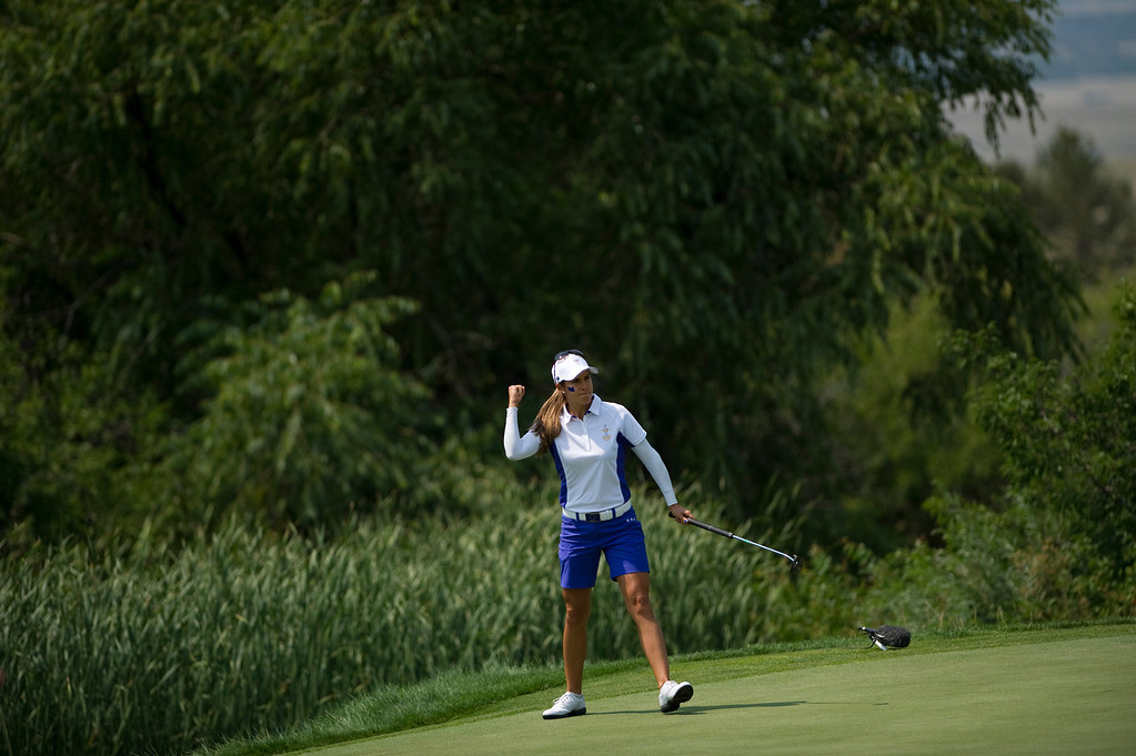. PARKER, CO - AUGUST 16: European Azahara Munoz celebrates as she sinks a putt to win the match on the hole seventeenth hole during the first day of the Solheim Cup at Colorado Golf Club, on August 16, 2013.  (Photo By Grant Hindsley/The Denver Post)