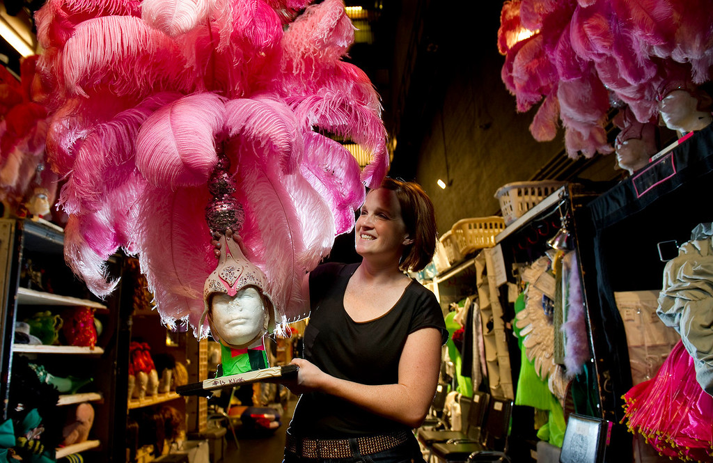 """. Wardrobe supervisor Gillian Austin holds one of the pink feather head pieces backstage at the Buell Theatre for the colorful production of \""""Priscilla Queen of the Desert The Musical\"""" on Thursday September 5, 2013. There are over 500 Tony Award winning costumes.   (Photo By Cyrus McCrimmon/The Denver Post )"""