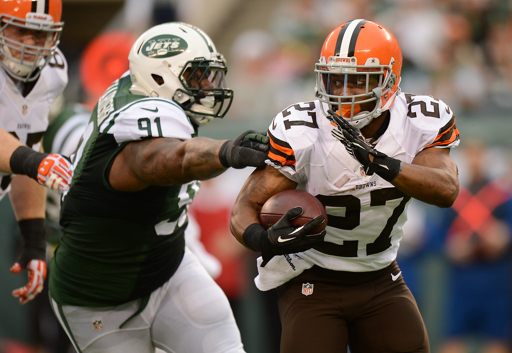 . EAST RUTHERFORD, NJ - DECEMBER 22:  Running back Edwin Baker #27 of the Cleveland Browns carries the ball during the first half against the New York Jets at MetLife Stadium on December 22, 2013 in East Rutherford, New Jersey. (Photo by Ron Antonelli/Getty Images)