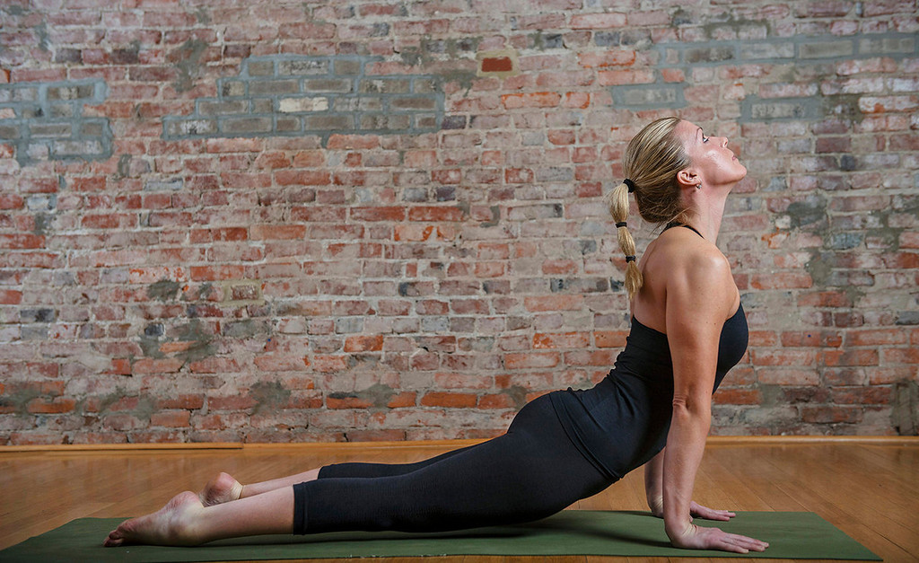 . Sun salutation, left to right:  7) Inhale, push your chest up, press your toes into the ground, so you�re in upward-facing dog.  (Photo for The Washington Post by Amanda Voisard.)