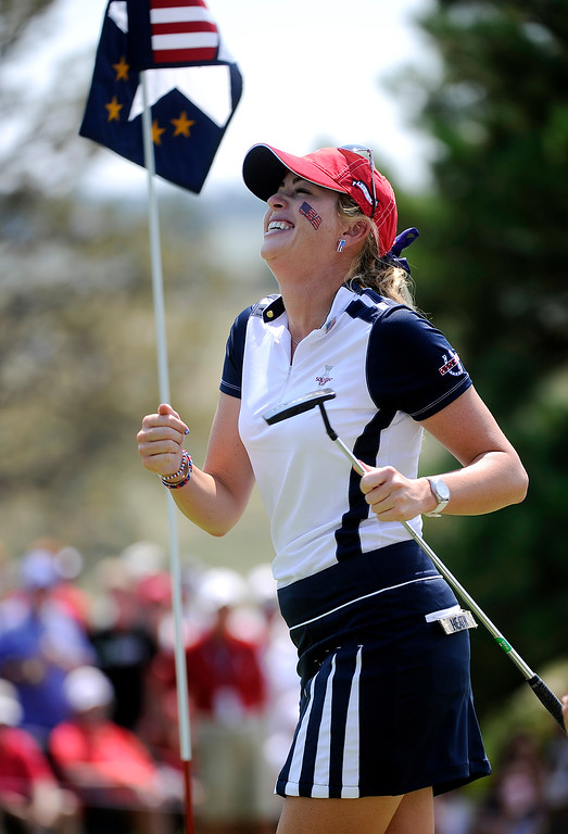 . PARKER, CO. - AUGUST 17: Paula Creamer celebrated on the 18th green after she and teammate Stacy Lewis went one up on the European pairing of Icher an Munoz at the Solheim Cup during morning competition. It was the American Team versus the Europeans as play continued at the Colorado Golf Club Saturday afternoon, August 17, 2013. Photo By Karl Gehring/The Denver Post