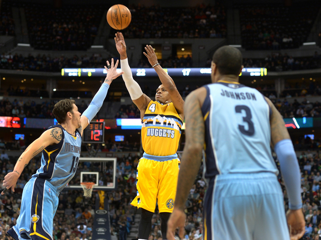 . DENVER, CO. - JANUARY 03:  Denver guard Randy Foye (4) put up a shot from long range in the first half. The Denver Nuggets hosted the Memphis Grizzlies at the Pepsi Center Friday night, January 3, 2014. Photo By Karl Gehring/The Denver Post