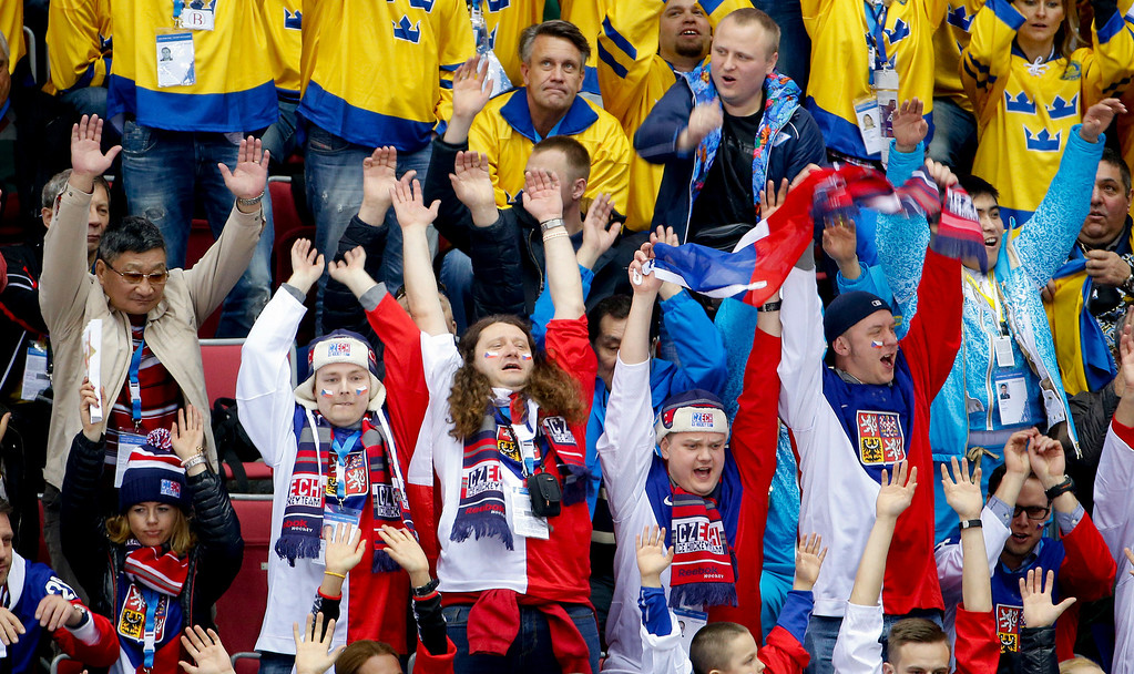 . Hockey fans do the wave during a timeout in the third period of a men\'s ice hockey game between Sweden and the Czech Republic at the 2014 Winter Olympics, Wednesday, Feb. 12, 2014, in Sochi, Russia. (AP Photo/Julio Cortez)
