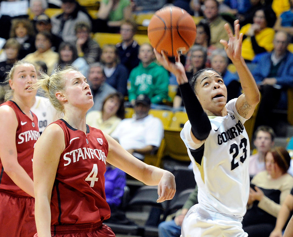 . University of Colorado\'s Chucky Jeffery takes a shot in front of Taylor Greenfield during a game against Stanford on Friday, Jan. 4, at the Coors Event Center on the CU campus in Boulder.    Jeremy Papasso/Camera