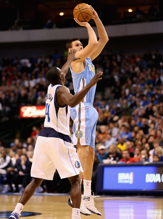 . DALLAS, TX - DECEMBER 28:  Danilo Gallinari #8 of the Denver Nuggets takes a shot against Darren Collison #4 of the Dallas Mavericks at American Airlines Center on December 28, 2012 in Dallas, Texas.  NOTE TO USER: User expressly acknowledges and agrees that, by downloading and or using this photograph, User is consenting to the terms and conditions of the Getty Images License Agreement.  (Photo by Ronald Martinez/Getty Images)