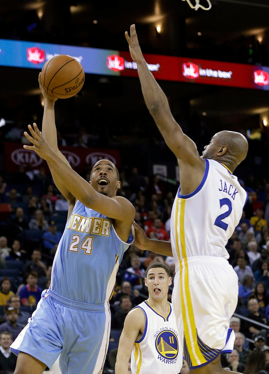 . Denver Nuggets\' Andre Miller (24) shoots past Golden State Warriors\' Jarrett Jack (2) during the first half of an NBA basketball game in Oakland, Calif., Thursday, Nov. 29, 2012. (AP Photo/Marcio Jose Sanchez)