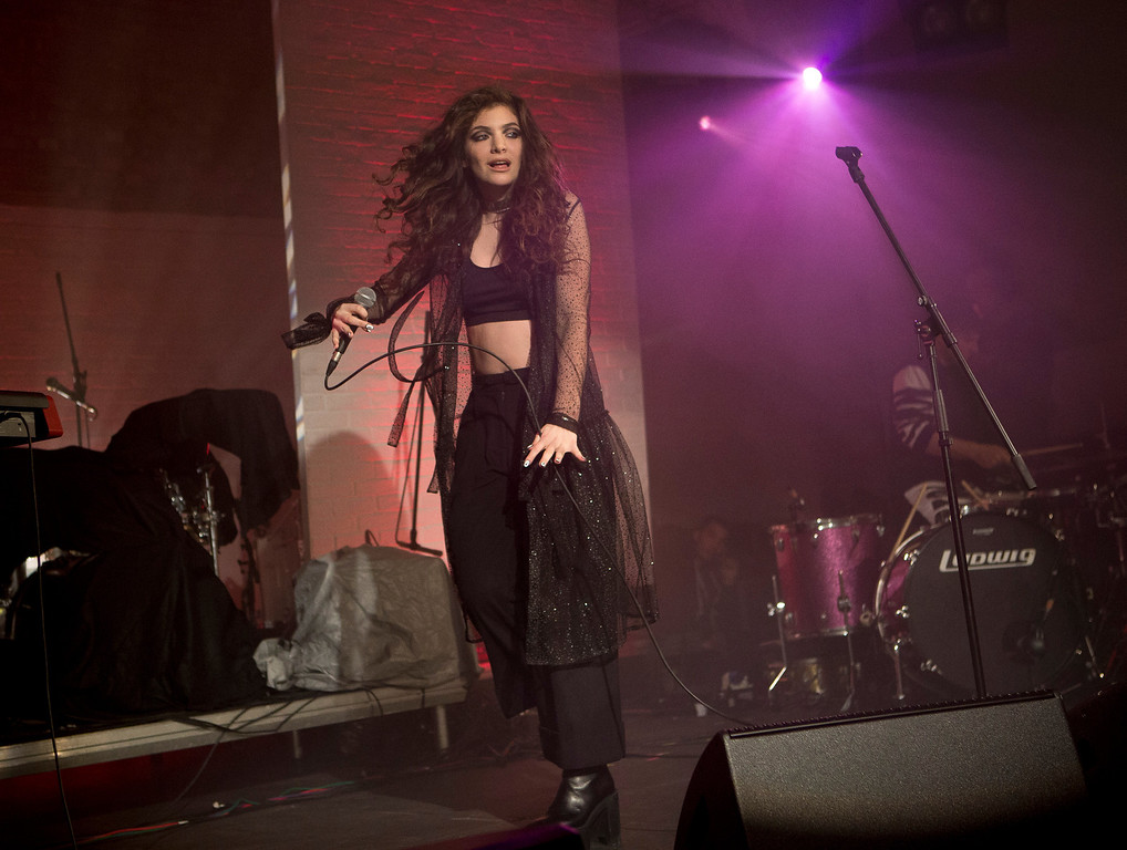 . FILE - In this Oct. 31, 2013 file photo, New Zealand singer-songwriter Lorde performs on stage during the Vevo Halloween Concert at the Oval Space in east London. Lorde has four nominations at the Grammy Awards on Sunday, Jan. 26, 2014, including song and record of the year for ìRoyals.î (Photo by Joel Ryan/Invision/AP, File)