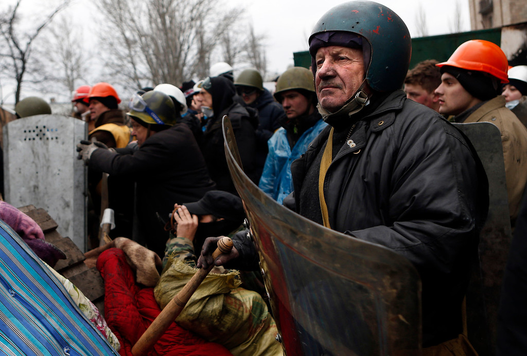 . Anti-government protesters man a barricade in central Kiev, Ukraine, Thursday, Feb. 20, 2014. (AP Photo/Darko Bandic)