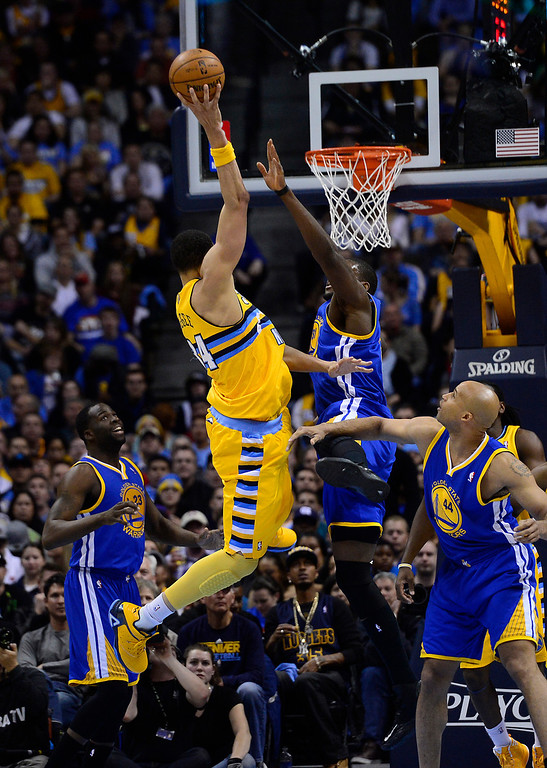 . DENVER, CO. - APRIL 23: Denver Nuggets center JaVale McGee (34) goes up for a shot in the second quarter. The Denver Nuggets took on the Golden State Warriors in Game 2 of the Western Conference First Round Series at the Pepsi Center in Denver, Colo. on April 23, 2013. (Photo by AAron Ontiveroz/The Denver Post)
