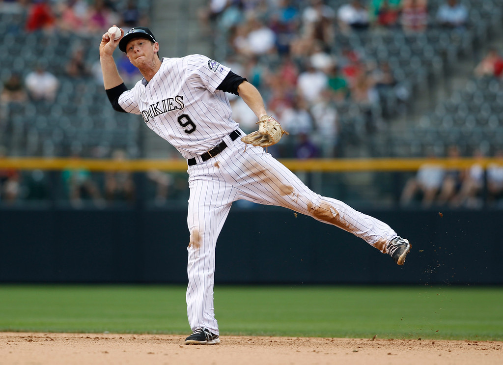 . Colorado Rockies second baseman DJ LeMahieu throws out Philadelphia Phillies\' Michael Young at first base in the ninth inning of a baseball game in Denver on Saturday, June 15, 2013.  The Rockies won 10-5. (AP Photo/David Zalubowski)
