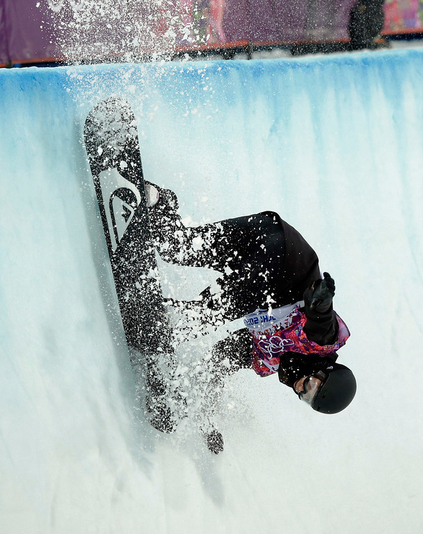 . Switzerland\'s Iouri Podladtchikov competes in the men\'s snowboard halfpipe semifinal at the Rosa Khutor Extreme Park, at the 2014 Winter Olympics, Tuesday, Feb. 11, 2014, in Krasnaya Polyana, Russia. (AP Photo/Andy Wong)