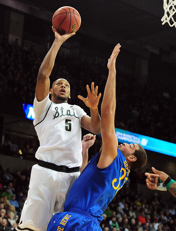 . Adreian Payne #5 of the Michigan State Spartans shoots over Carl Baptiste #33 of the Delaware Fightin Blue Hens during the second round of the 2014 NCAA Men\'s Basketball Tournament at Spokane Veterans Memorial Arena on March 20, 2014 in Spokane, Washington.  (Photo by Steve Dykes/Getty Images)