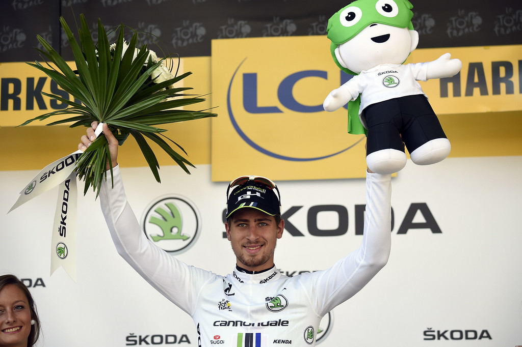 . Slovakia\'s Peter Sagan celebrates his white jersey of best young on the podium at the end of the 190.5 km first stage of the 101st edition of the Tour de France cycling race on July 5, 2014 between Leeds and Harrogate, northern England.  The 2014 Tour de France gets underway on July 5 in the streets of Leeds and ends on July 27 down the Champs-Elysees in Paris. ERIC FEFERBERG/AFP/Getty Images