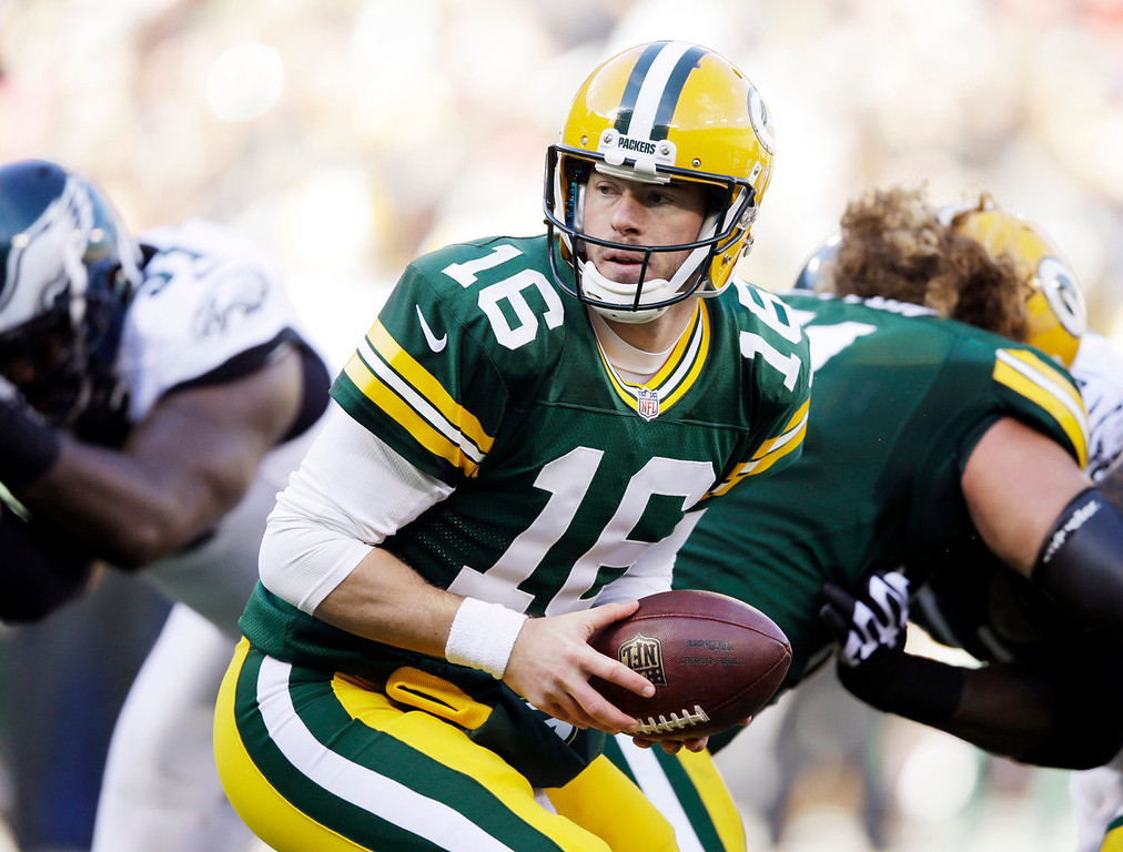 . Green Bay Packers quarterback Scott Tolzien takes a snap during the first half of an NFL football game against the Philadelphia Eagles Sunday, Nov. 10, 2013, in Green Bay, Wis. Tolzien replaced an injured Seneca Wallace. (AP Photo/Tom Lynn)