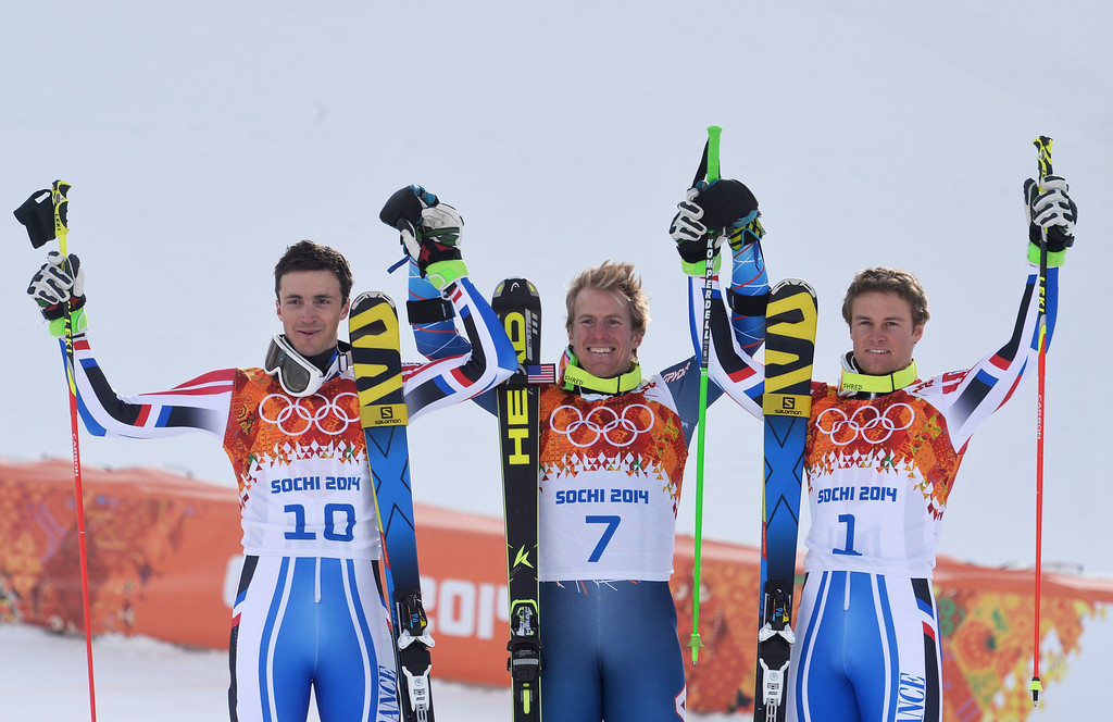 . (L-R) Silver medallist France\'s Steve Missillier, gold medallist US skier Ted Ligety and bronze France\'s Alexis Pinturault stand on the podium during the Men\'s Alpine Skiing Giant Slalom Flower Ceremony at the Rosa Khutor Alpine Center during the Sochi Winter Olympics on February 19, 2014.   AFP PHOTO / DIMITAR DILKOFF/AFP/Getty Images