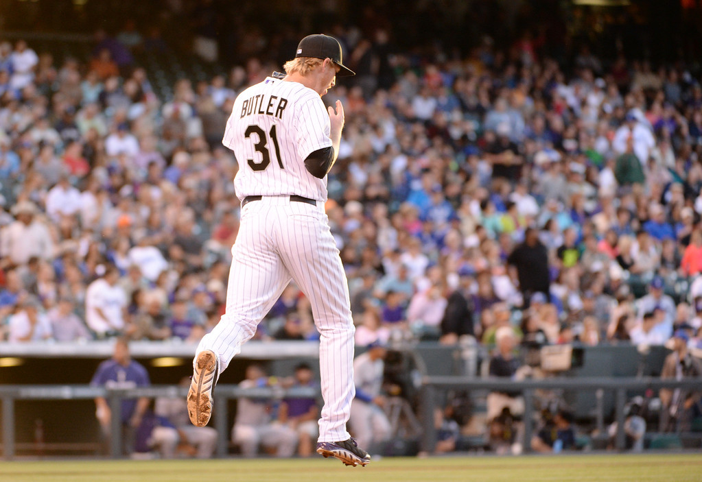 . DENVER JUNE 06: Eddie Butler of Colorado Rockies (31) is heading pitching mound during the game against Los Angeles Dodgers at Coors Field in Denver, Colorado June 6, 2014. (Photo by Hyoung Chang/The Denver Post)