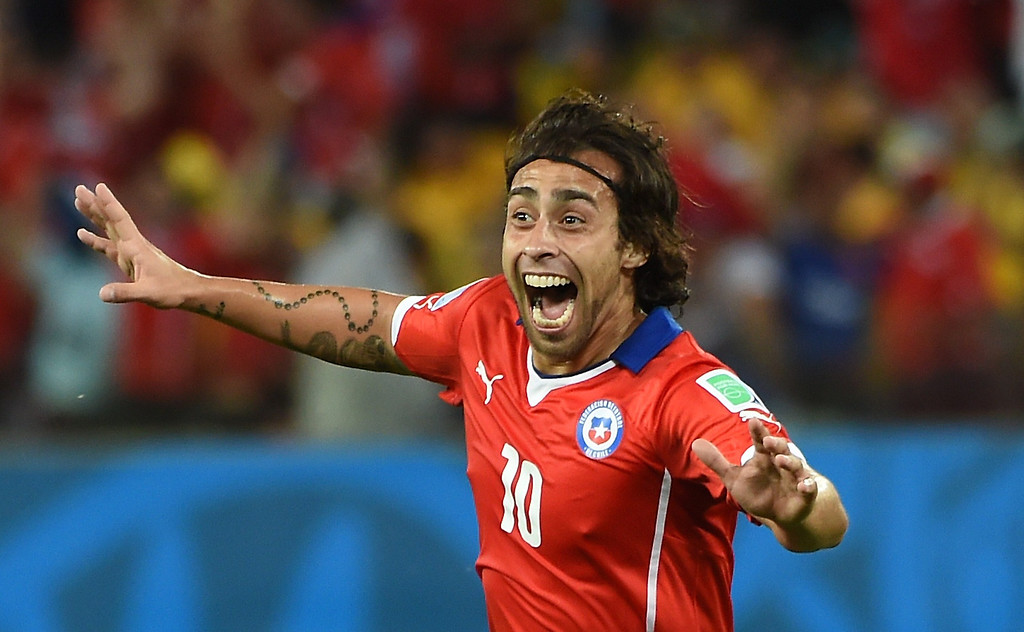 . Chile\'s forward Jorge Valdivia celebrates after scoring during a Group B football match between Chile and Australia at the Pantanal Arena in Cuiaba during the 2014 FIFA World Cup on June 13, 2014.  AFP PHOTO / WILLIAM WEST