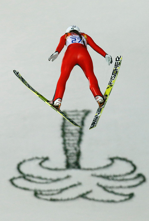 . Russia\'s Irina Avvakumova makes her first attempt during the women\'s normal hill ski jumping final at the 2014 Winter Olympics, Tuesday, Feb. 11, 2014, in Krasnaya Polyana, Russia. (AP Photo/Gregorio Borgia)