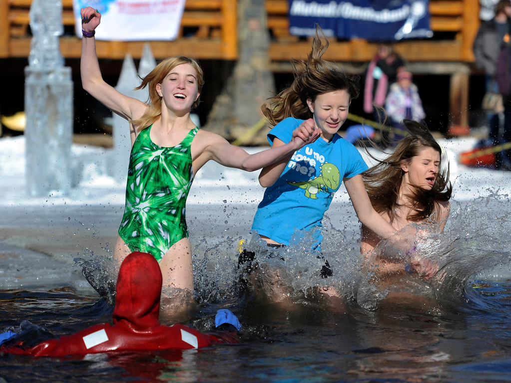 . Dozens joined in for the 6th annual Evergreen Lake Plunge on New Years Day, 2013, where only the very brave jumped, dove, and even performed a belly flop into the icy waters of Evergreen Lake. Entering as a team of three are from left to right Abby Lee, 14, Hannah Dart, 14, and Katarina Ignacek, 14. Kathryn Scott Osler, The Denver Post