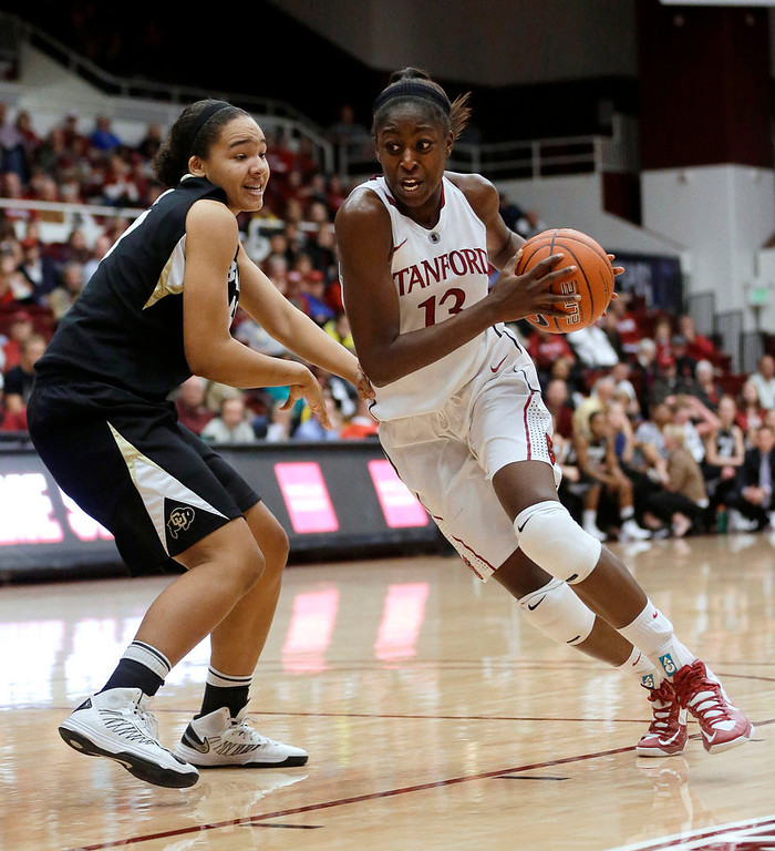 . Stanford\'s Chiney Ogwumike (13) dribbles past Colorado\'s Jamee Swan during the second half of an NCAA college basketball game in Stanford, Calif., Sunday, Jan. 27, 2013. Stanford won 69-56. (AP Photo/Marcio Jose Sanchez)