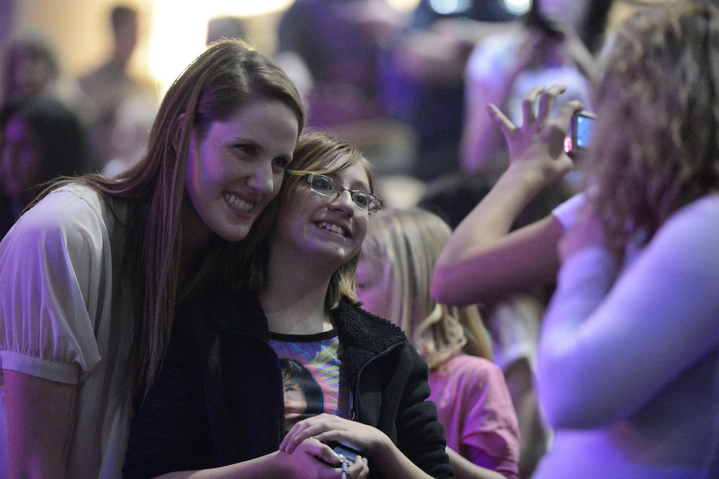 . Missy Franklin takes a picture with a fan as they attend the Justn Bieber who performed to a sold out crowd at Pepsi Center during his  \'Believe\' Tour stop in Denver. John Leyba, The Denver Post