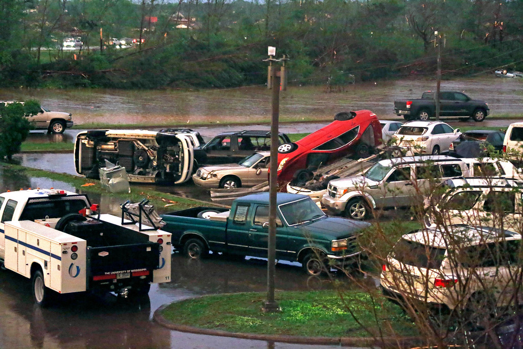 . Tornado damaged automobiles clutter the parking lot of the Winston Medical Center in Louisville, Miss., Monday, April 28, 2014. The facility, its parking lot and a neighboring nursing home were among the properties heavily damaged by a tornado. Tornados flattened homes and businesses, flipped trucks over on highways and injured numerous  people in Mississippi and Alabama on Monday as a massive, dangerous storm system passed over several states in the South, threatening additional twisters as well as severe thunderstorms, damaging hail and flash floods. (AP Photo/Rogelio V. Solis)