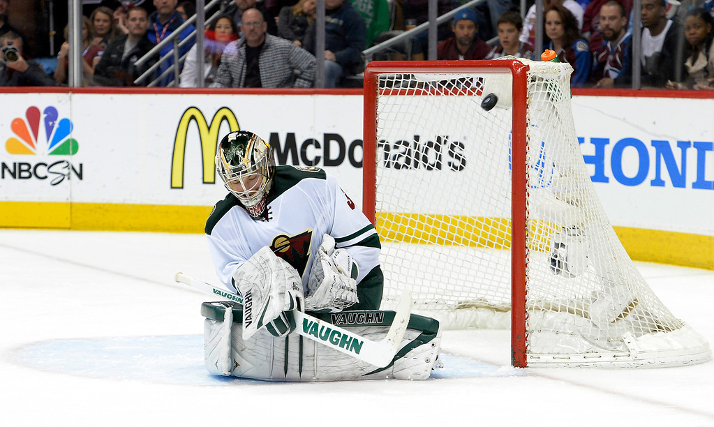 . DENVER, CO - APRIL 26: Minnesota Wild goalie Darcy Kuemper (35) looks down as the puck hits the post during the second period of action. The Colorado Avalanche hosted the Minnesota Wild in the fifth round of the Stanley Cup Playoffs at the Pepsi Center in Denver, Colorado on Saturday, April 26, 2014. (Photo by John Leyba/The Denver Post)