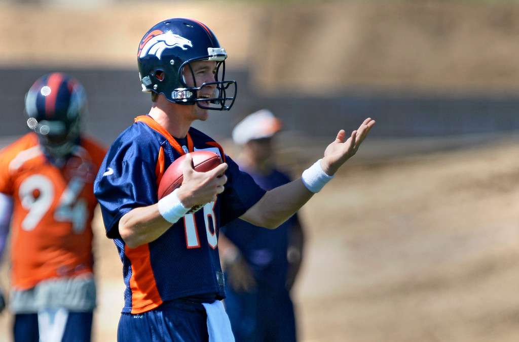 . Denver Broncos Peyton Manning (18) shouts out directions in drills during OTAs June 10, 2014 at Dove Valley. (Photo by John Leyba/The Denver Post)