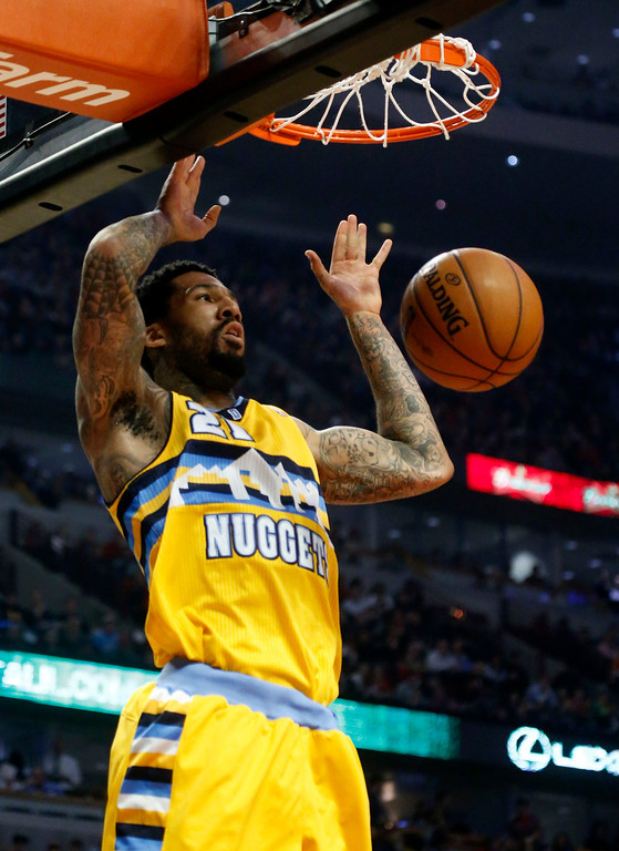 . Denver Nuggets guard Wilson Chandler dunks the balls during the first half of an NBA basketball game against the Chicago Bulls, Monday, March 18, 2013, in Chicago. (AP Photo/Charles Rex Arbogast)