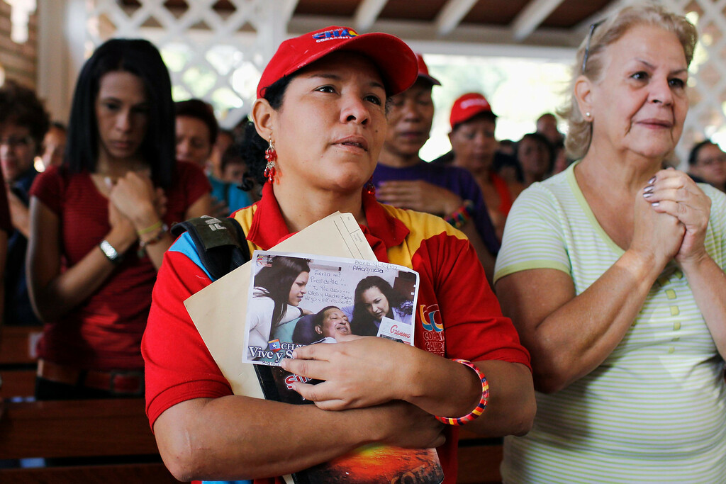 ". Supporters of Venezuelan President Hugo Chavez pray in a chapel outside the Caracas military hospital in Caracas March 5, 2013. Chavez\'s adoring supporters prayed and wept on Tuesday over a serious setback in his battle against a cancer that threatens to end his 14-year rule of the South American OPEC member. In one of the gloomiest announcements to date on Chavez\'s health, the government said on Monday night that his breathing problems had worsened and he was suffering from a ""severe\"" new respiratory infection in a Caracas military hospital. REUTERS/Carlos Garcia Rawlins"