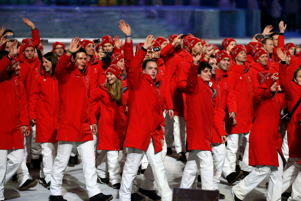 . Athletes from Switzerland wave to spectators as they arrive during the opening ceremony of the 2014 Winter Olympics in Sochi, Russia, Friday, Feb. 7, 2014. (AP Photo/Mark Humphrey)