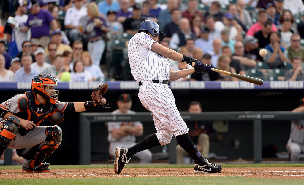 . Todd Helton (17) of the Colorado Rockies hits a two run home run off of Matt Cain (18) of the San Francisco Giants during the second inning May 16, 2013 at Coors Field. (Photo By John Leyba/The Denver Post)