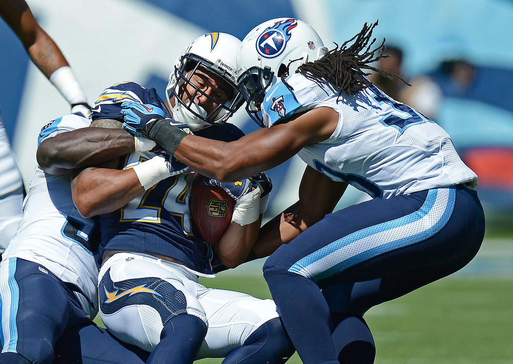 . San Diego Chargers running back Ryan Mathews (24) is stopped by Tennessee Titans safety Michael Griffin (33) in the first quarter of an NFL football game on Sunday, Sept. 22, 2013, in Nashville, Tenn. (AP Photo/Mark Zaleski)