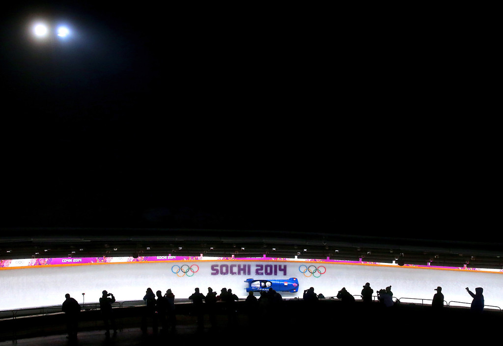. Pilot Loic Costerg and Romain Heinrich of France team 1 make a run during the Men\'s Two-Man Bobsleigh heats on Day 9 of the Sochi 2014 Winter Olympics at Sliding Center Sanki on February 16, 2014 in Sochi, Russia.  (Photo by Alex Livesey/Getty Images)