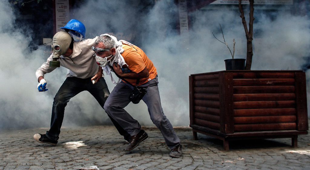 . Demonstrators try to escape from riot police on June 11, 2013 on Taksim square in Istanbul. AFP Photo / ANGELOS TZORTZINIS/AFP/Getty Images