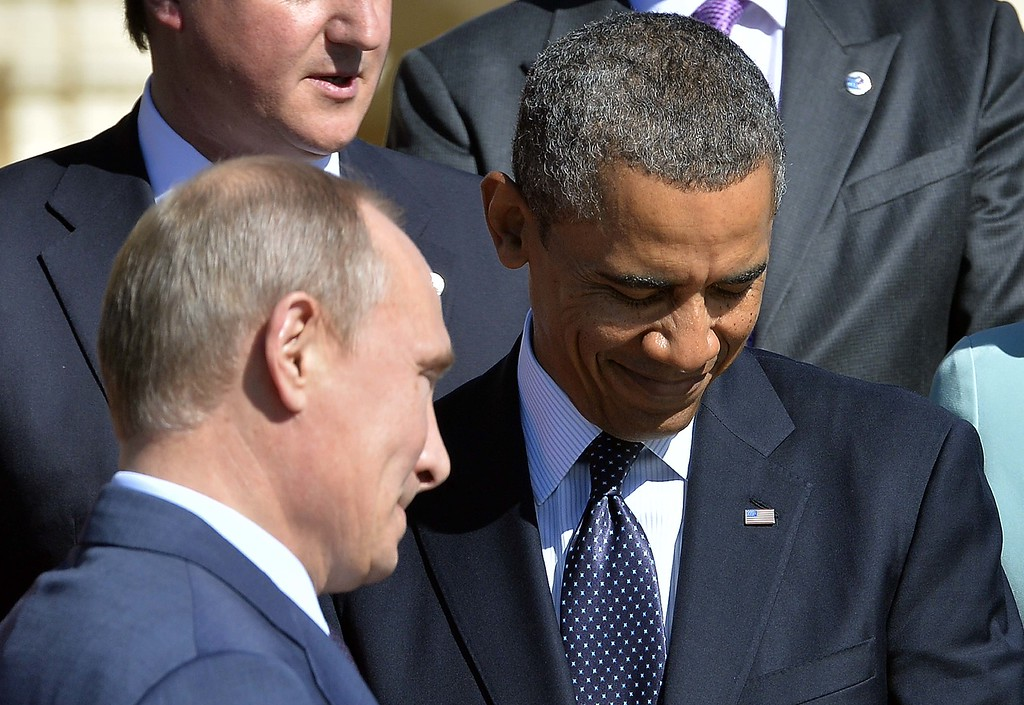 . Russias President Vladimir Putin (L) walks past US President Barack Obama as he arrives to pose for the family photo during the G20 summit on September 6, 2013 in Saint Petersburg. World leaders at the G20 summit on Friday failed to bridge their bitter divisions over US plans for military action against the Syrian regime, with Washington signalling that it has given up on securing Russia\'s support at the UN on the crisis. JEWEL SAMAD/AFP/Getty Images